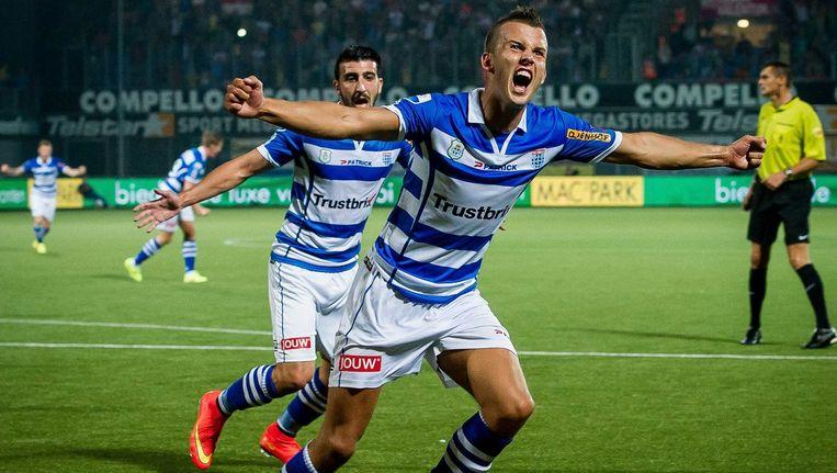 PEC Zwolle-speler Jesper Drost juicht na de 1-0 tegen FC Utrecht. Beeld anp