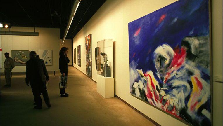 Rechts een schilderij van Roger Somville;