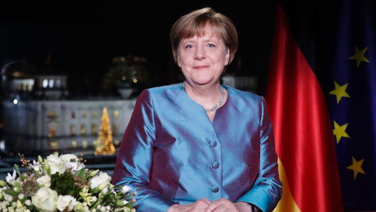 Angela Merkel bij haar nieuwjaarstoespraak. Beeld AFP