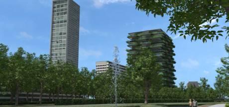 Woontoren Spoorpark Tilburg : lager, groen, met plint