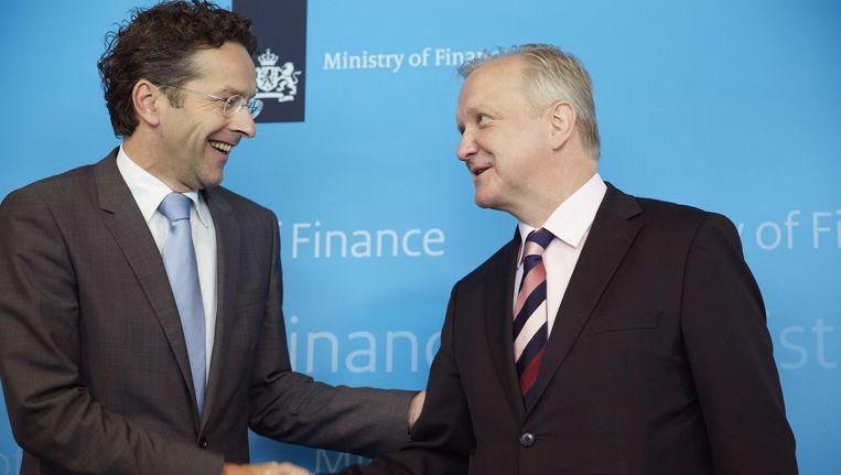 Minister Jeroen Dijsselbloem (L) van Financien ontmoet Eurocommissaris Olli Rehn, juni 2013. Beeld null
