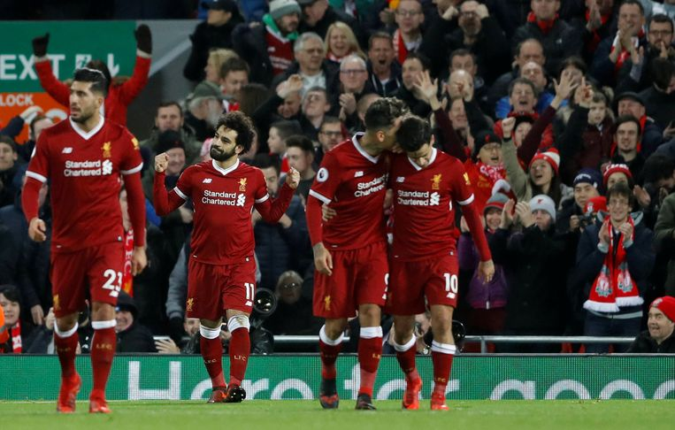 "Soccer Football - Premier League - Liverpool vs Leicester City - Anfield, Liverpool, Britain - December 30, 2017   Liverpool's Mohamed Salah celebrates with team mates after scoring their second goal    Action Images via Reuters/Carl Recine    EDITORIAL USE ONLY. No use with unauthorized audio, video, data, fixture lists, club/league logos or ""live"" services. Online in-match use limited to 75 images, no video emulation. No use in betting, games or single club/league/player publications.  Please contact your account representative for further details."