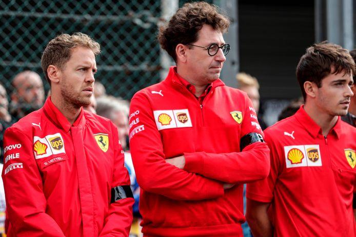 Mattia Binotto (au centre) et Vettel (à gauche)