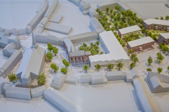 De nieuwe academie, rechts naast de kerk, zal er in de toekomst zo gaan uitzien.