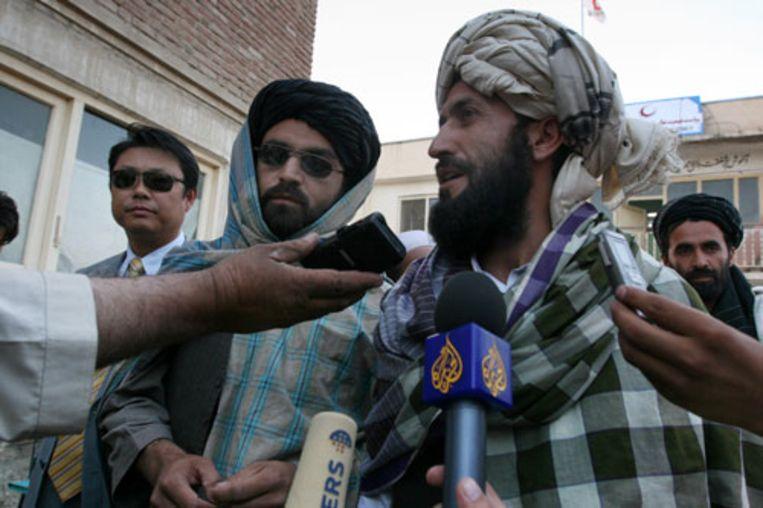 Taliban-woordvoerder Mawlawi Nasrullah op een bijeenkomst met de pers in de buurt van Kabul. (AP) Beeld