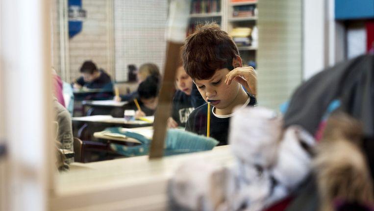 Een leerling van groep 8 maakt de Cito-toets, 7 februari 2012. © ANP Beeld
