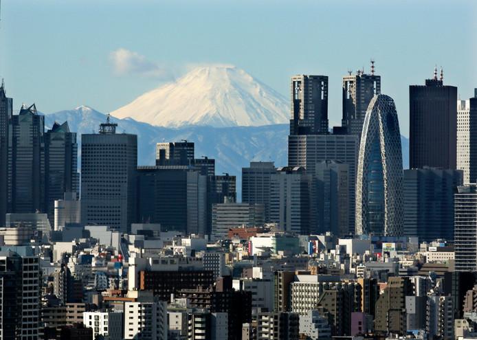 Foto van Tokio met Mount Fuji op de achtergrond.