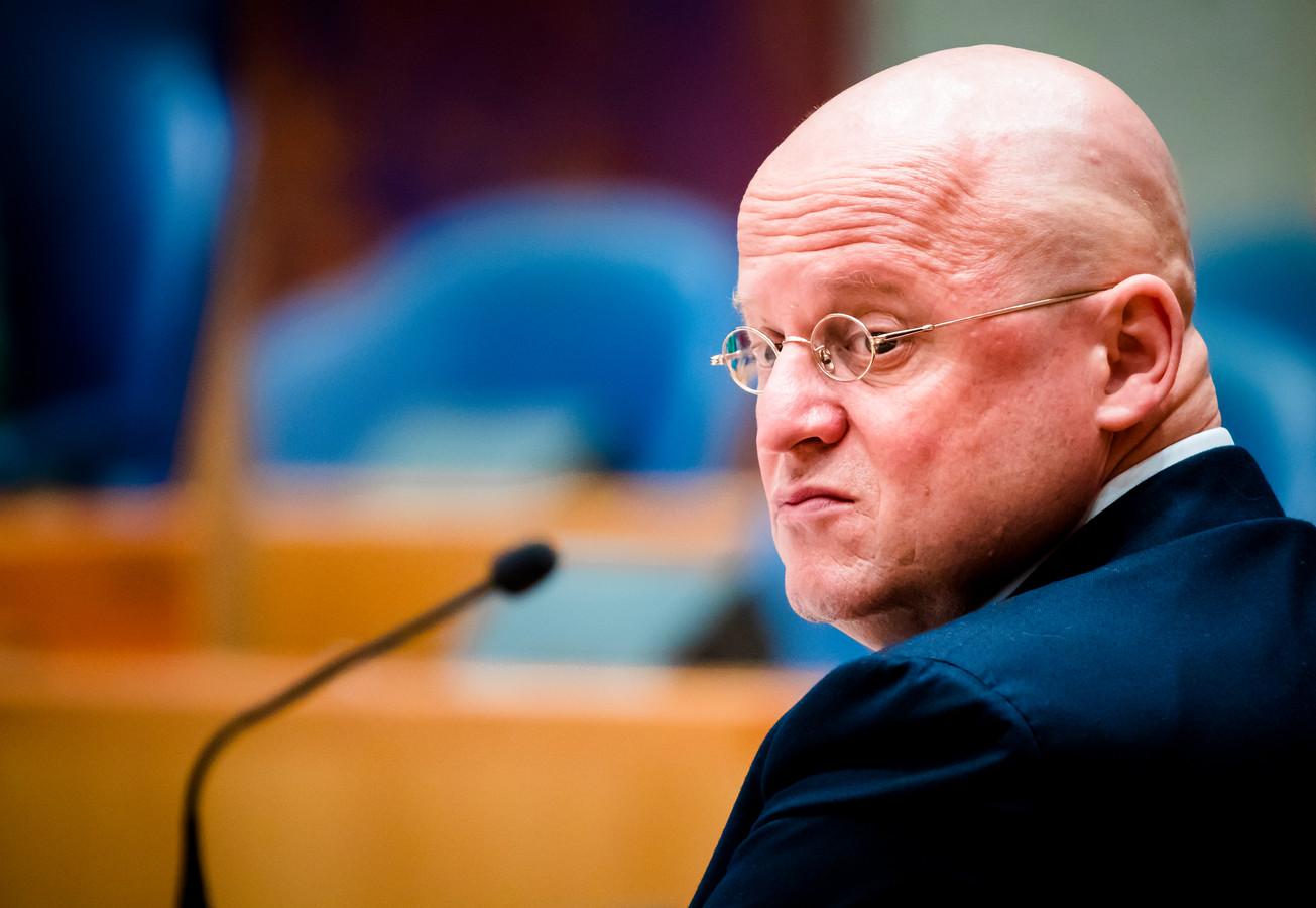 Ferd Grapperhaus van Justitie en Veiligheid tijdens een debat in de Tweede Kamer.