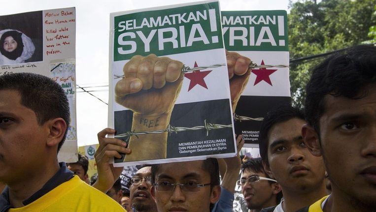 Protesten in Maleisië tegen het Syrische regime. Beeld epa