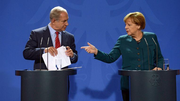 De Israëlische premier Netanyahu en de Duitse bondskanselier Merkel. Beeld EPA