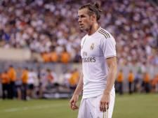 Ziek in Madrid achtergebleven Bale betrapt op potje golfen