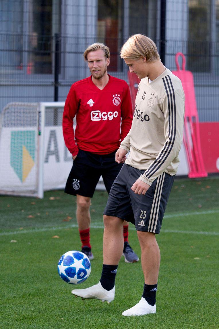 Christian Poulsen (l) en Kasper Dolberg Beeld anp