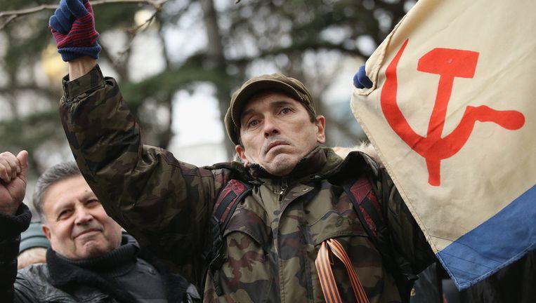 Pro-Russische supporter voor het parlement van de Krim in Sebastopol. Beeld getty