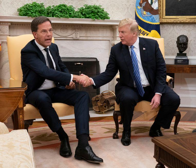 Premier Rutte ontmoet president Donald Trump in het Witte Huis. Beeld EPA