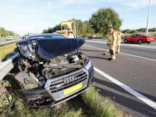 Auto in vangrail op A58 bij Oirschot na incident met vrachtwagen
