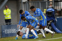 De gevallen Stijn Spierings wordt gefeliciteerd door zijn ploeggenoten na zijn wonderschone doelpunt.
