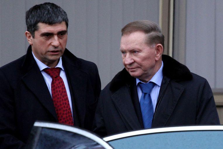 De Contactgroep Oekraïne wil vandaag in de Wit-Russische hoofdstad Minsk overleggen over onder meer een staakt-het-vuren. Oud-president Leonid Koetsjma van Oekraïne (rechts op de foto) is daar al aangekomen.