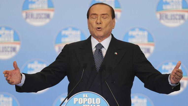 Ex-premier van Italië Berlusconi, vandaag in Milaan. Beeld null