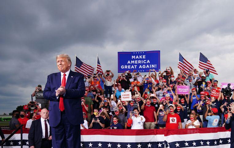 Donald Trump op een campagnebijeenkomst begin september. Beeld AFP