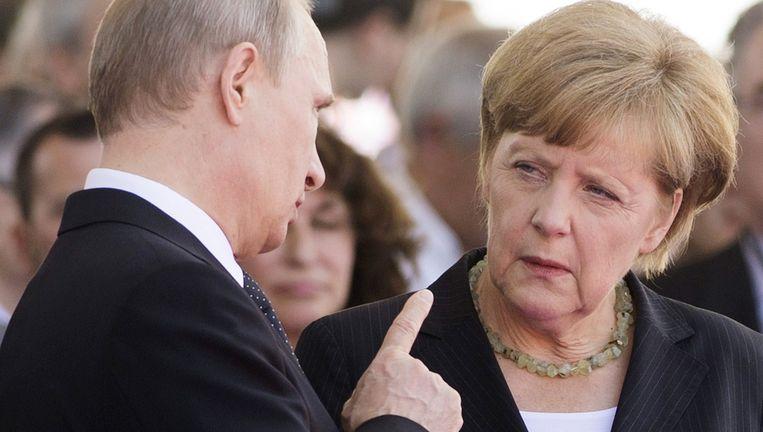 Poetin en Merkel. Beeld AFP