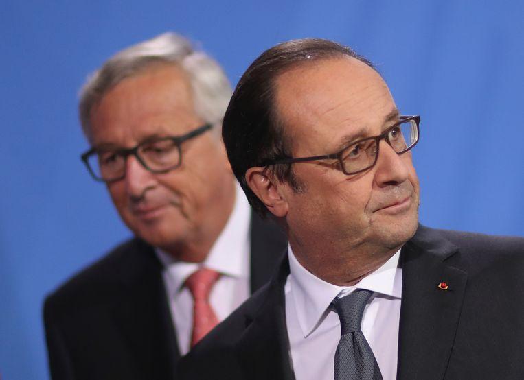 Toenmalige president van Frankrijk Francois Hollande en Jean-Claude Juncker in Berlijn, anno 2016.  Beeld Getty Images