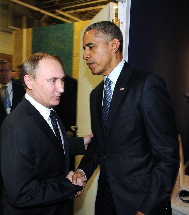 Poetin en Obama ontmoeten elkaar in Parijs. Beeld epa