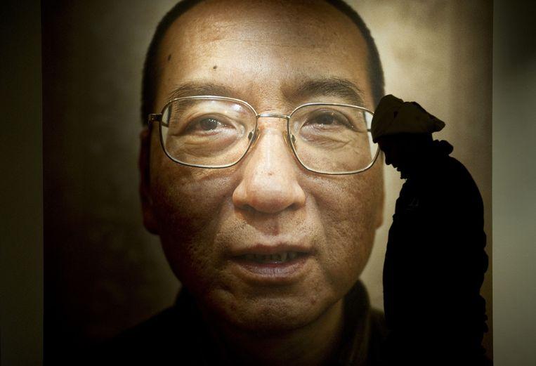 Liu Xiaobo bij een expositie van het Nobel Peace Center in Oslo in 2010. Beeld afp
