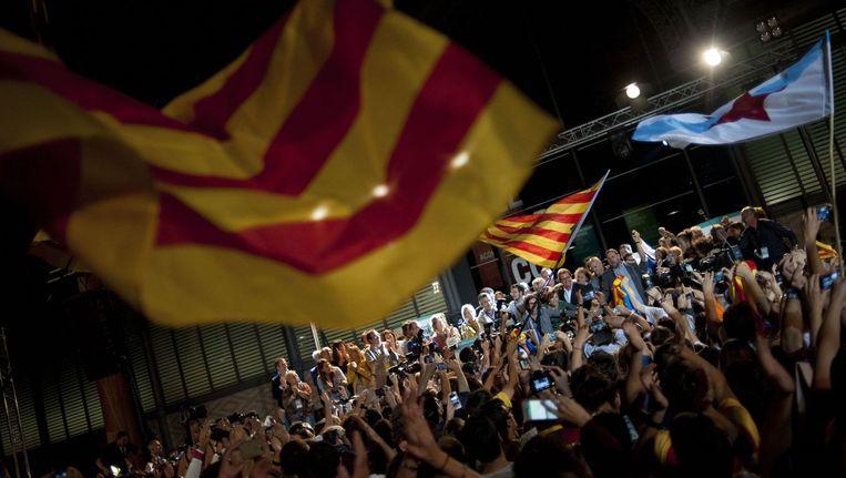 Drukte in de straten in Catalonië. Beeld anp