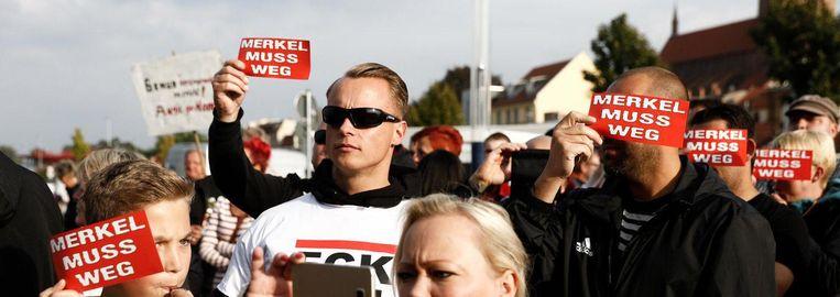 Demonstranten verstoren regelmatig partijbijeenkomsten van Merkels partij CDU Beeld Daniël Rosenthal/de Volkskrant
