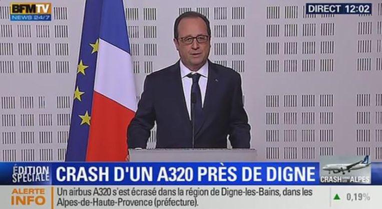 Screenshot van de Franse president François Hollande tijdens de persconferentie. Beeld