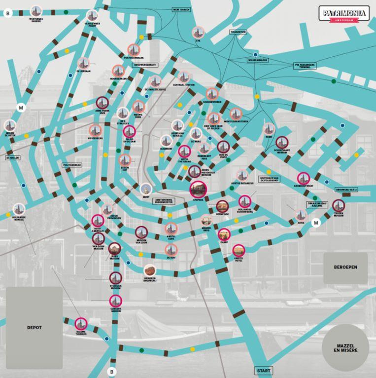 Het bord is een kaart van de binnenstad van Amsterdam, met vijftig monumenten Beeld Patrimonia Amsterdam