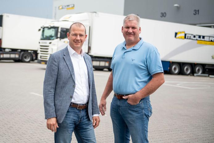Anton en Jan Peter Muller van transportbedrijf Muller. Het bedrijf werkt op volle kracht om winkels te bevoorraden.
