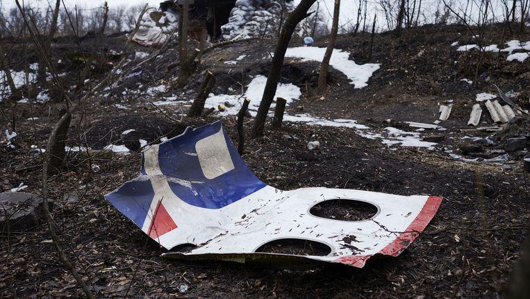 Resten van de MH17 bij een verlaten wegblokkade vlakbij Nikishyne, ten noordwesten van Grabovo. Beeld ANP