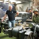 Eef Peeters te midden van een klein deel van zijn enorme verzameling Duitse  voertuigen bij het Arnhems Oorlogsmuseum 40- 45.
