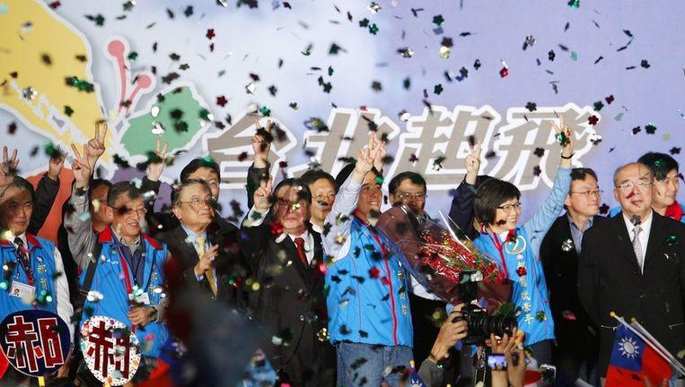 De Nationalistische Partij van Taiwan (Kwomintang) viert de verkiezingsoverwinning afgelopen vrijdag. Beeld reuters