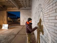 Graffitikunstenaar Stephan Peters maakt van somber tunneltje 'poort naar de stad'