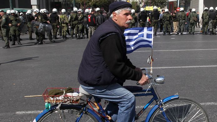 Een Griek op een fiets.