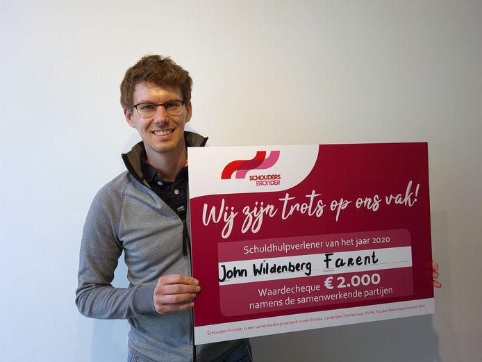 John Wildenberg met de waardecheque.