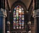 Een deel van het gedenkraam in de Hubertuskerk in Ooij vertelt het verhaal over de evacuatie van Nijmegenaren aan het eind van de Tweede Wereldoorlog.