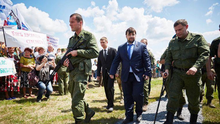 De leider van de opstandige Oost-Oekraïense regio Donetsk, Aleksandr Zachartsjenko (rechts). Beeld anp