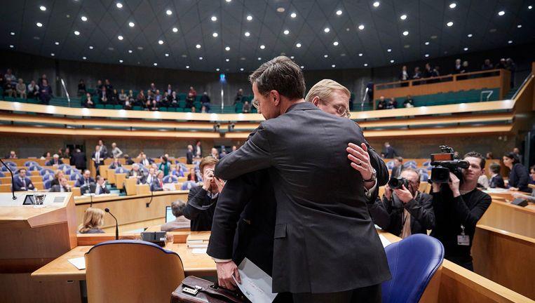 Minister Van der Steur in omhelzing met premier Rutte. Beeld Phil Nijhuis