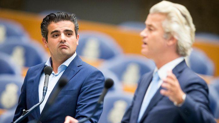 Fractievoorzitter van Denk Tunahan Kuzu en PVV leider Geert Wilders tijdens het plenair debat in de Tweede Kamer over de nasleep van de legercoup in Turkije Beeld anp