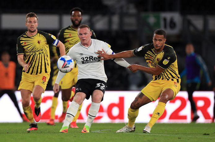William Troost-Ekong in duel met Wayne Rooney.