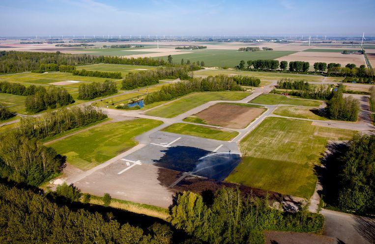 Het festivalterrein van Lowlands en Defqon. Nederland kan zich opmaken voor een festivalloze zomer. Het kabinet heeft het verbod op evenementen vanwege de coronacrisis verlengd tot 1 september. Beeld ANP