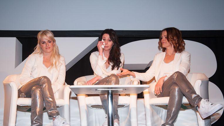 Josje, Kristel en Karen woensdag op de persconferentie waar ze hun stoppen aankondigen. Beeld BELGA