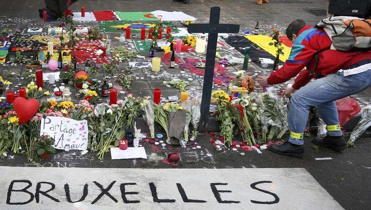 Een bloemenmonument op straat in Brussel. Beeld reuters
