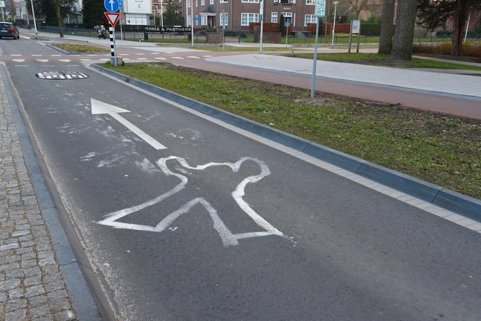 Silhouet van een mens op de plek van het ongeluk.