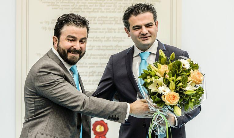 Partijvoorzitter Selcuk Öztürk (L) en lijsttrekker Tunahan Kuzu tijdens de opening van het partijbureau van de politieke beweging DENK. Beeld anp