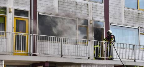 Veel rookschade door brand in de keuken van appartement in Tilburg