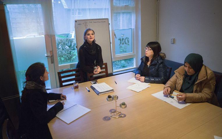 Cursisten volgen een workshop bij PIT 010 Campus in Rotterdam. Beeld null